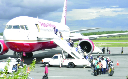 Guyanese boarding Aircraft at Cheddi Jagan International Airport