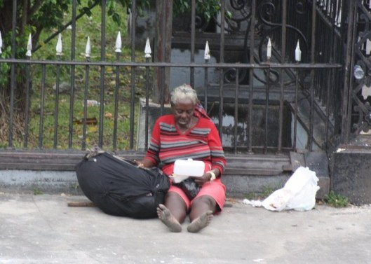 Homeless Woman outside Parliament Buildings - Georgetown - Guyana