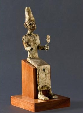 Seated statue of El